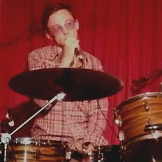 David Lyttle announcing from the drums at the Hotel Cafe, Hollywood